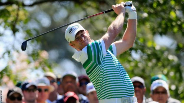 Jamie Donaldson watches his tee shot on the fourth hole during the first round