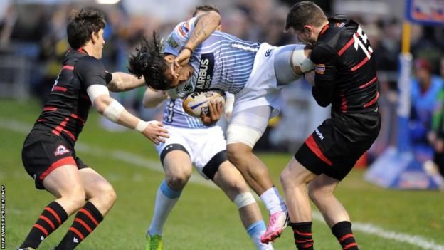 Cardiff Blues centre Isaia Tuifua is tackled by Edinburgh full-back Jack Cuthbert in the Pro12 at Meggatland