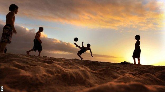 Children play football in South Africa