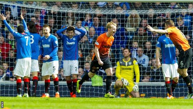 Rangers players are dejected as Gary Mackay-Steven celebrates Dundee United's second goal