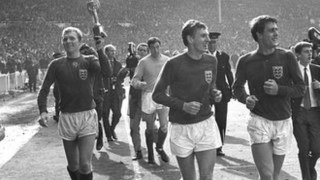 Bobby Moore and Geoff Hurst celebrate with the World Cup trophy in 1966