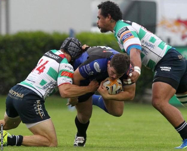 Elliott Dee is halted as Newport Gwent Dragons take on Treviso in Italy in the Pro12