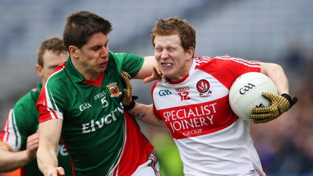 Mayo's Lee Keegan is shrugged off by Enda Lynn during Derry's dramatic victory over the Connacht champions