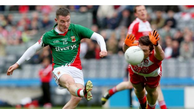 Mickey Sweeney sees a shot blocked by Oisin Duffy as Brian McIver's side book a place in the Division One final