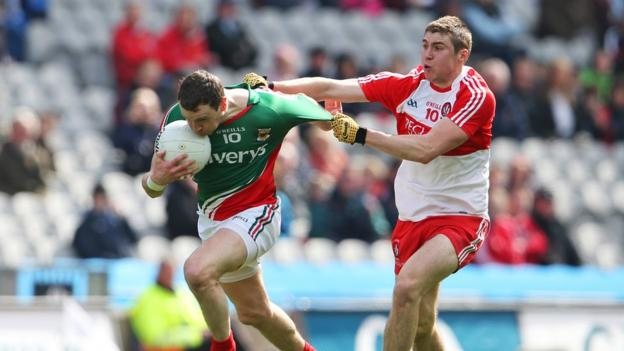 Derry's Ciaran McFaul gets to grips with Keith Higgins in a see-saw encounter at Croke Park