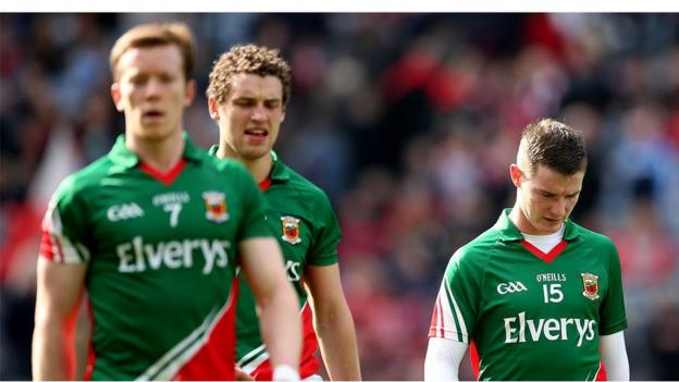 Mayo players leave the field dejected after failing to beat 14-man Derry in Dublin