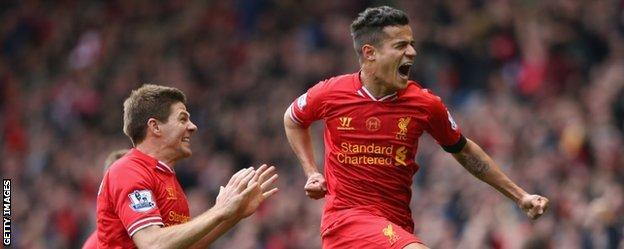 Philippe Coutinho celebrates after scoring Liverpool's winner