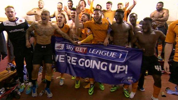 The Wolves players celebrate winning promotion at Gresty Road