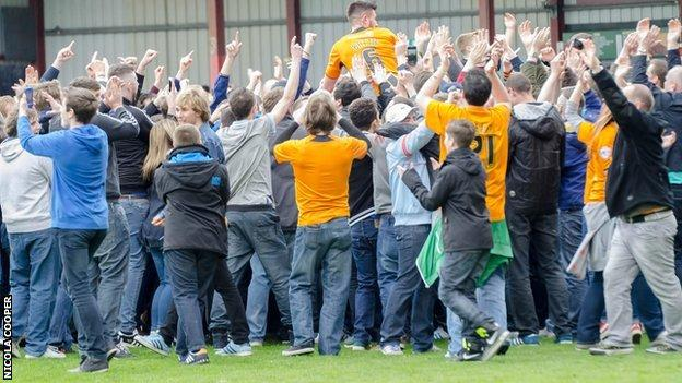 Wolves defender Danny Batth is chaired off by the travelling Wolves fans at Gresty Road