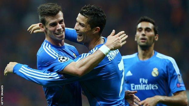 Gareth Bale celebrates with Cristano Ronaldo