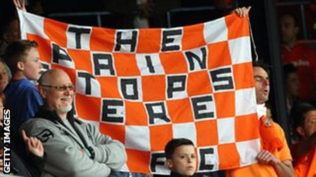 Luton fans with a flag