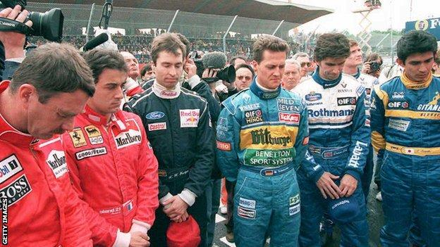 Formula 1 drivers observe a minute of silence to commemorate the first anniversary of the death of fellow drivers Ayrton Senna of Brazil and Roland Ratzenberger of Austria