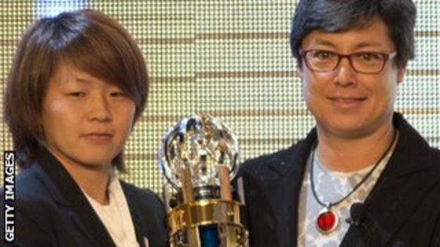 Moya Dodd (right) presents the Asian Football Confederation Women's Player of the Year award to Japan's Aya Miyama