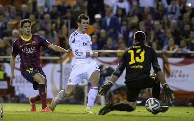 Real Madrid's Gareth Bale scores the winner in their 2-1 win against Barcelona in Spain's Copa del Rey final