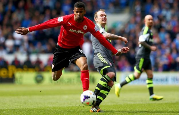 Cardiff City's Fraizer Campbell evades Glenn Whelan of Stoke City in their Premier League clash in the Welsh capital