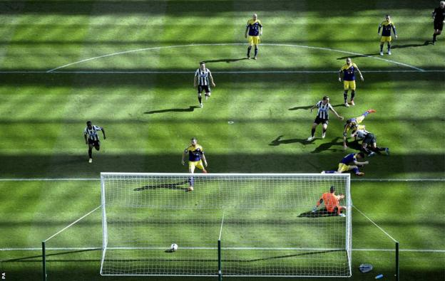 Newcastle's Shola Ameobi scores his sides opening goal against the Swans