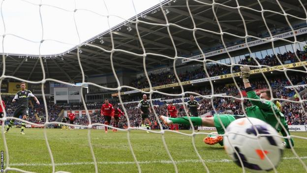 Marko Arnautovic of Stoke City fires the Potters in front from the penalty spot in first-half injury time during the Premier League match against Cardiff City