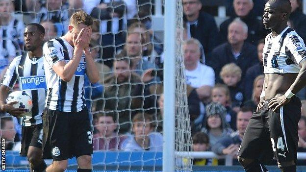 Newcastle players react after losing to Swansea