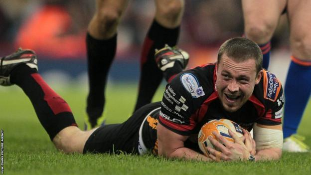 Dragons scrum-half Richie Rees dives over to give his side the lead against the Ospreys at the Millennium Stadium