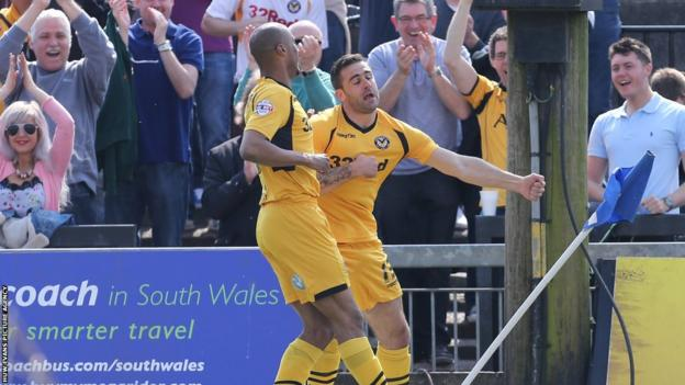 Andy Sandell celebrates with Chris Zebrowski after giving Newport County the lead against Burton Albion in League Two at Rodney Parade on Easter Monday