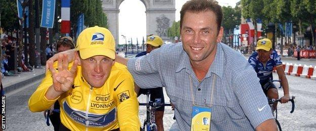 Lancer Armstong with Johan Bruyneel after winning his fourth Tour de France