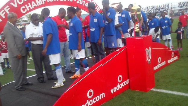 Azam players receive their league winners' medals