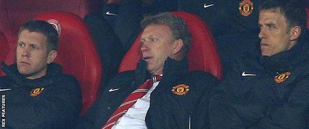 Moyes slumps in his seat in the dugout during United's first leg Champions League defeat to Olympiakos