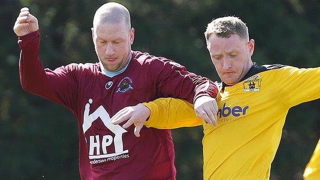 Institute's Stephen O'Flynn tussles with H&W Welders player Craig Harris