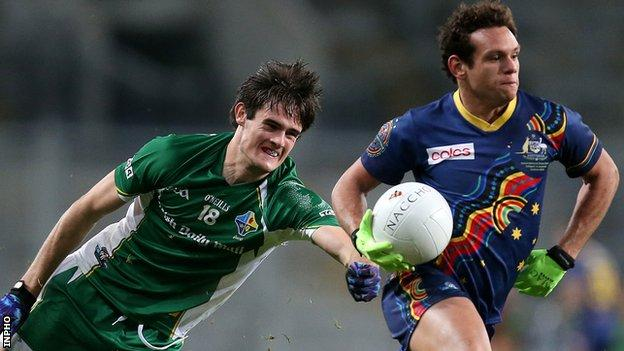 Ireland's Chrissy McKaigue in action against Steven Motlop of Australia at Croke Park in October 2013