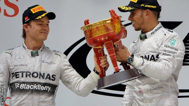 Nico Rosberg and Lewis Hamilton on the podium at the Chinese Grand Prix