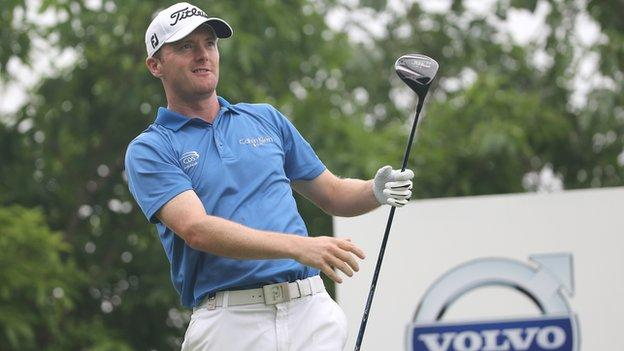 Michael Hoey watches a drive during the first round at the China Open