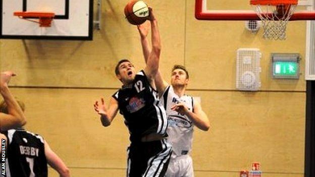 Derby's Alex Dorr battling for a rebound against Ipswich's Leigh Greenan