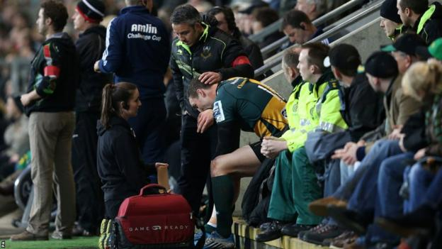 George North receives treatment on the bench after coming off the field