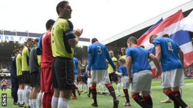 The Stranraer players form a guard of honour for Scottish League One winners Rangers