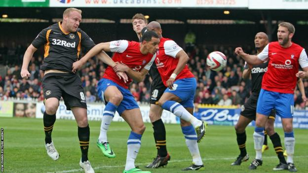 Lee Minshull's header hits the post as Newport County face York City in their penultimate game of the League Two season.