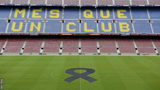 Barcelona have laid a black ribbon in the centre of the pitch at the Nou Camp.