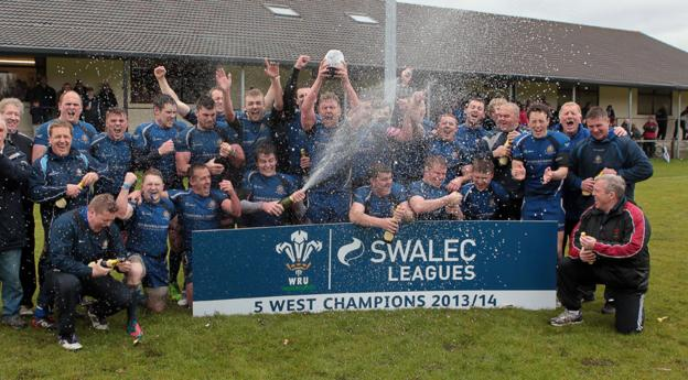 The champagne flies as New Dock Stars celebrate being crowned Welsh Rugby Union League 5 West champions