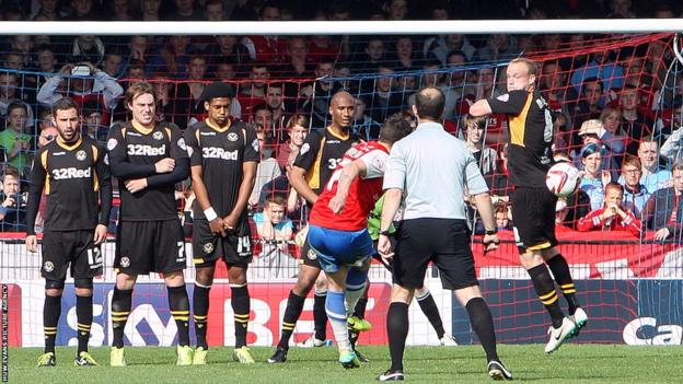 Michael Coulson's free-kick beats Newport County goalkeeper Ian McLoughlin to give York City the lead