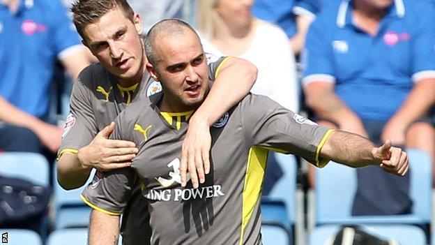 Gary Taylor-Fletcher (right) celebrates scoring for Leicester at Huddersfield