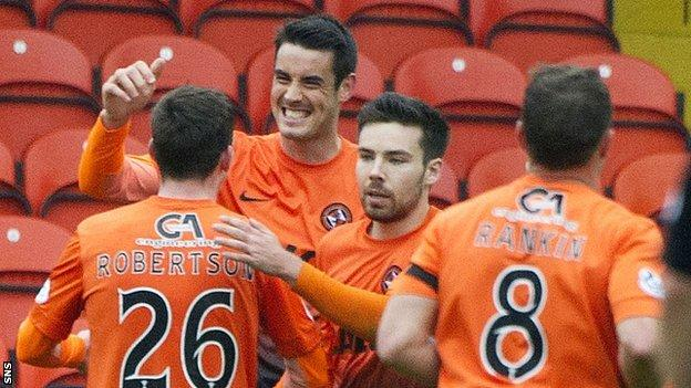 The Dundee United players congratulate Brian Graham on his goal
