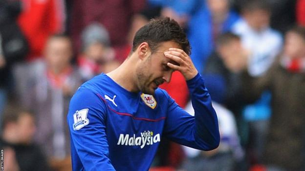 Cardiff City's Juan Cala holds his head after being sent off in the 4-0 defeat at Sunderland