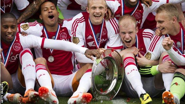 Ajax players celebrate the title