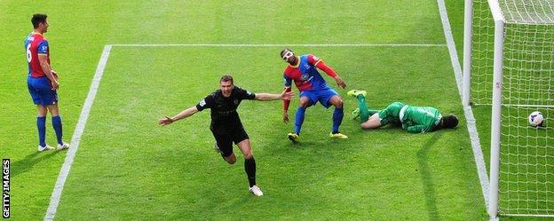 Edin Dzeko celebrates giving Manchester City the lead against Crystal Palace