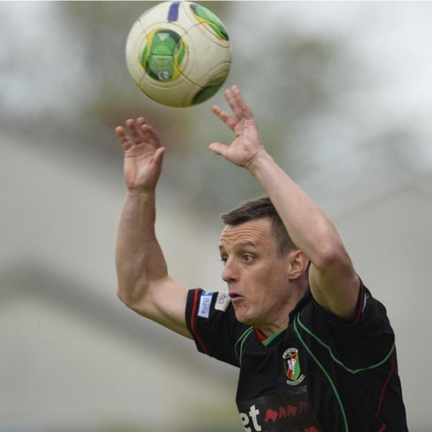 Glentoran's retiring defender Jason Hill made his 327th and final appearance for the club in the 3-0 win over Portadown