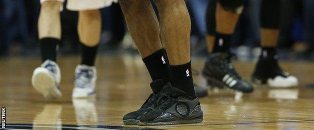 San Antonio Spurs and Dallas Mavericks players wear black socks in support of Los Angeles Clippers colleagues