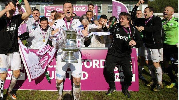 Ryan Young helps AFC Telford United celebrate their Conference North title triumph at the Bucks Head