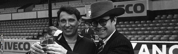 Graham Taylor and then-owner Sir Elton John in 1984, a year Watford would reach the FA Cup final