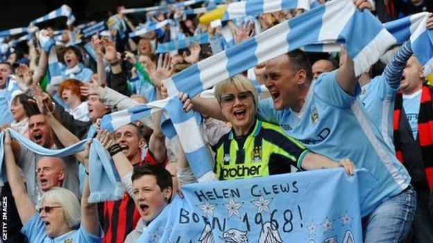 Manchester City fans celebrate their Premier League title win in 2012 after beating QPR