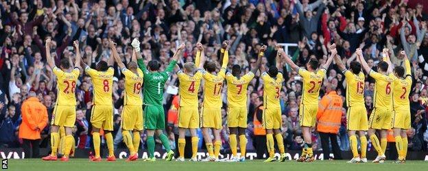 Crystal Palace's players applaud the travelling fans after match against West Ham