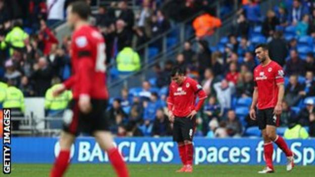 Cardiff players are dejected after the defeat to Crystal Palace